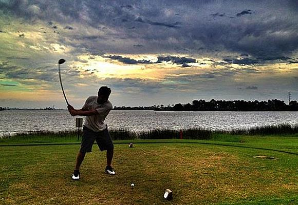 Golfer in the sunset